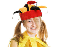 Young blond woman in fool's cap Stock Images