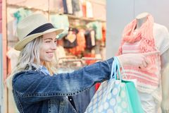 Young blond woman in front of a boutique royalty free stock images
