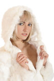 A young blond woman in a fur witner hoodie. A young and attractive blond Caucasian woman posing in a white fur witner hoodie. The image is isolated on a white Stock Images