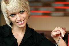 Young blond woman with a gentle smile. Portrait of a young blond woman with a gentle smile and trendy modern short hairstyle with copyspace Stock Images