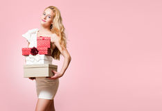 Young blond woman with gift boxes. Royalty Free Stock Photo