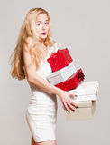 Young blond woman with gift boxes. Royalty Free Stock Photos