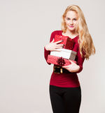 Young blond woman with gift boxes. Portrait of a gorgeous young blond woman with Christmas gift boxes Royalty Free Stock Images