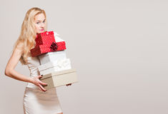 Young blond woman with gift boxes. Royalty Free Stock Images