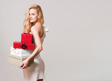 Young blond woman with gift boxes. Stock Image