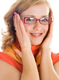 Young blond woman with glasses in hand Stock Images