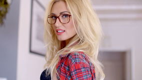 Young Blond Woman with Glasses Looking at Camera stock video footage