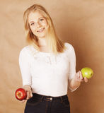 Young blond woman with green and red apple, good Stock Images