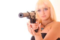 Young blond woman with gun isolated Royalty Free Stock Photos