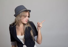 Young blond woman in hat and jacket Royalty Free Stock Images