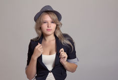 Young blond woman in hat and jacket Royalty Free Stock Photography