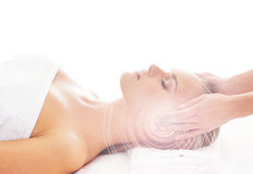 A young blond woman on a head massage procedure Royalty Free Stock Photo