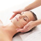 A young blond woman on a head massage procedure Royalty Free Stock Image