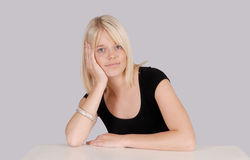 Young blond woman head resting on her hand Stock Image