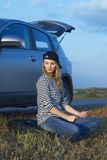 Young Blond Woman With Her Broken Car Stock Image