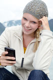 Young blond woman with her Smartphone in the hand Stock Images