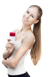 Young blond woman holding antiperspirant Stock Image