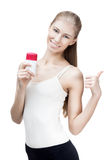 Young blond woman holding antiperspirant Stock Photos