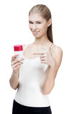 Young blond woman holding antiperspirant Stock Photography