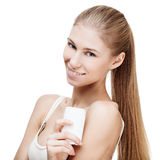 Young blond woman holding antiperspirant Royalty Free Stock Photos