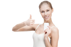 Young blond woman holding antiperspirant Stock Images