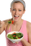 Young Blond woman holding a bowl of salad Stock Photo