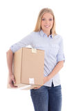 Young blond woman holding cardboard moving box isolated on white Stock Images