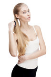 Young blond woman holding comb isolated on white Stock Photography