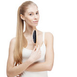 Young blond woman holding comb isolated on white Stock Images