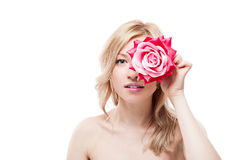 Young blond woman holding flower Stock Images