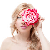 Young blond woman holding flower Royalty Free Stock Photo