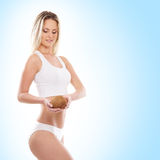 A young blond woman holding a fresh coconut Stock Photos