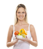 A young blond woman holding a fresh salad Stock Image