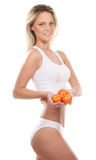 A young blond woman holding fresh tomatoes Royalty Free Stock Photos