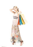 A young blond woman holding shopping bags Stock Image