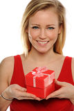 Young Blond Woman Holding a valentine gift. Young Blond Woman wearing a red dress Holding a valentine gift Royalty Free Stock Images