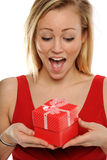 Young Blond Woman Holding a valentine gift Stock Photos