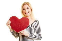Young woman holds heart for Valentine`s Day Royalty Free Stock Image