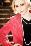 Young Blond Woman In Red Jacket Stock Photo