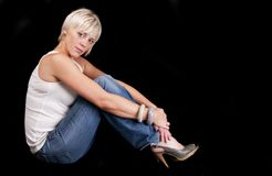 Young blond woman in jeans & vest Stock Photo