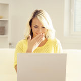 Young blond woman with a laptop Stock Photography
