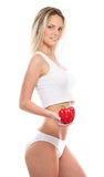 A young blond woman in lingerie holding a paprika Stock Image