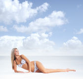 A young blond woman in lingerie relaxing on the beach Royalty Free Stock Image