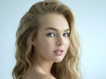 Young blond woman with long curly hair royalty free stock images