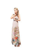 A young blond woman in a long dress Royalty Free Stock Photo
