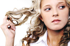 Young blond woman with long hair. Royalty Free Stock Photos