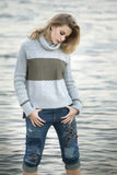 A young blond woman looking down at Lake Michigan water. Royalty Free Stock Photos