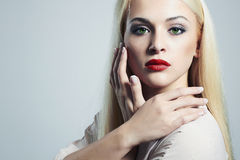 Young Blond woman with manicure.Beautiful model with make-up Stock Images