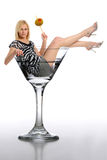 Young Blond Woman in a martini glass Royalty Free Stock Images