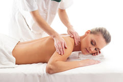 A young blond woman on a massage procedure Stock Photo